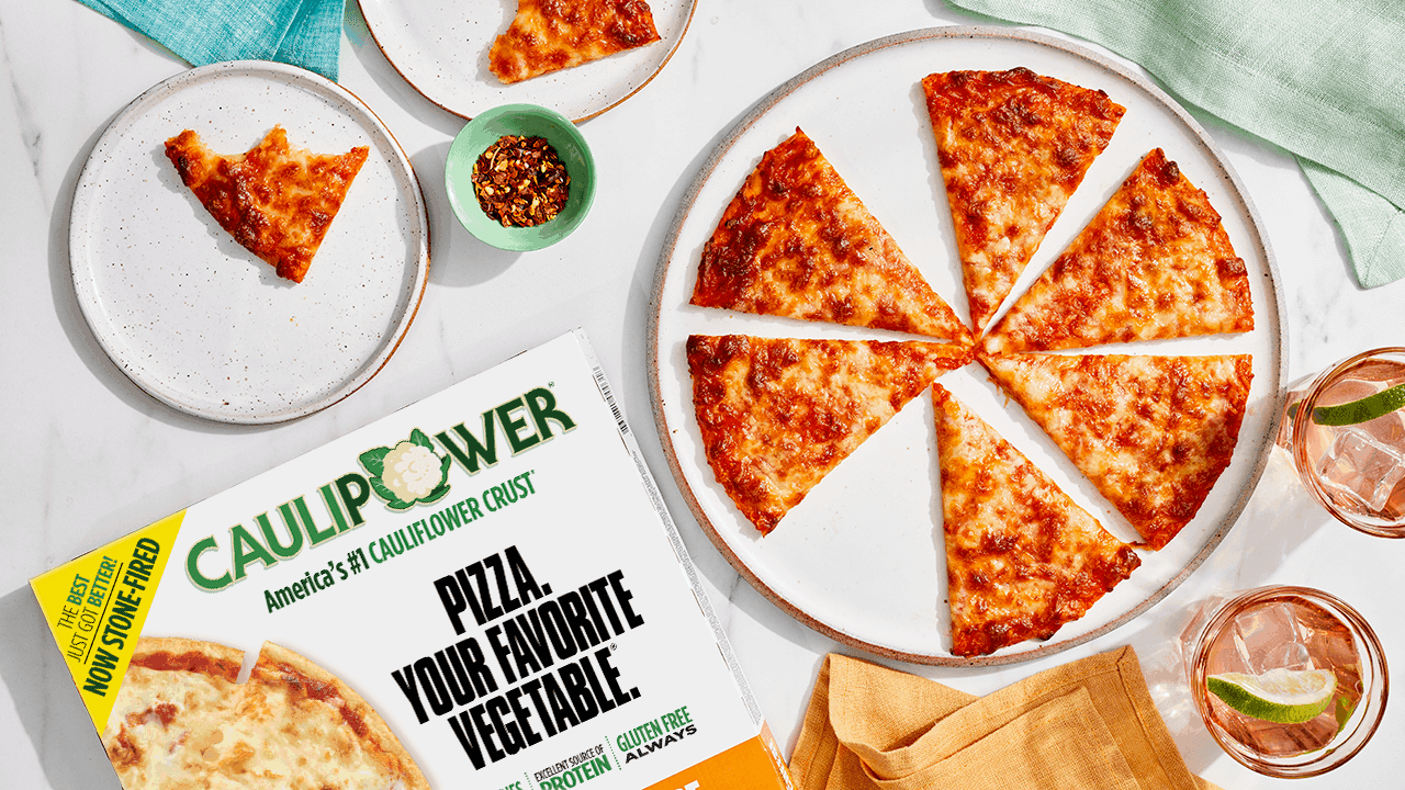 A tablescape with CAULIPOWER three cheese pizza
